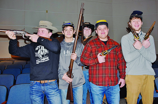 Lex Hooper, Wade Hamilton, Samson Jones Candler Edwards and Drey Keener (from left) handle some weaponry, which was part of the Civil War unit at Robbinsville High School on Monday. Photos by Art Miller/amiller@grahamstar.com