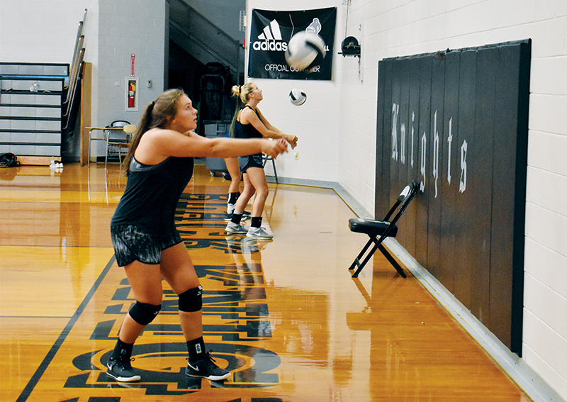 Robbinsville's Ivy Odom (front) and Kensley Phillips work through a drill at a July 23 workout. Knights volleyball and cross-country will begin their 2020-21 season next month, but COVID-19 restrictions will keep spectators at a minimum. Photo by Kevin Hensley/editor@grahamstar.com