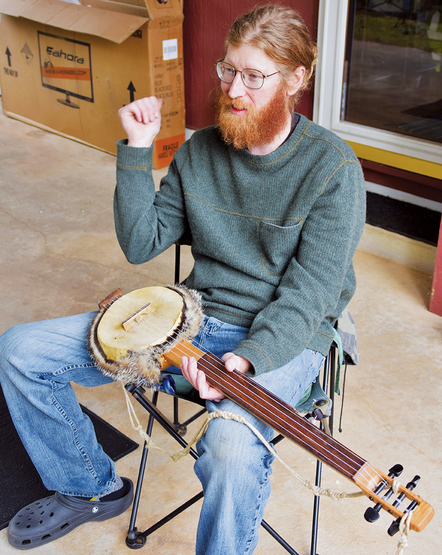 Almond resident Joshua Grant constructs banjos that harken back to those played in the mid-1800s.