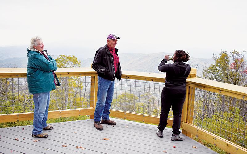 Pennsylvania residents Jo and Tony Stefanon (left, center) chat with Texas native Aja Stefanon about the breathtaking views at the Maple Springs Observation Deck. Photos by Kevin Hensley/editor@grahamstar.com