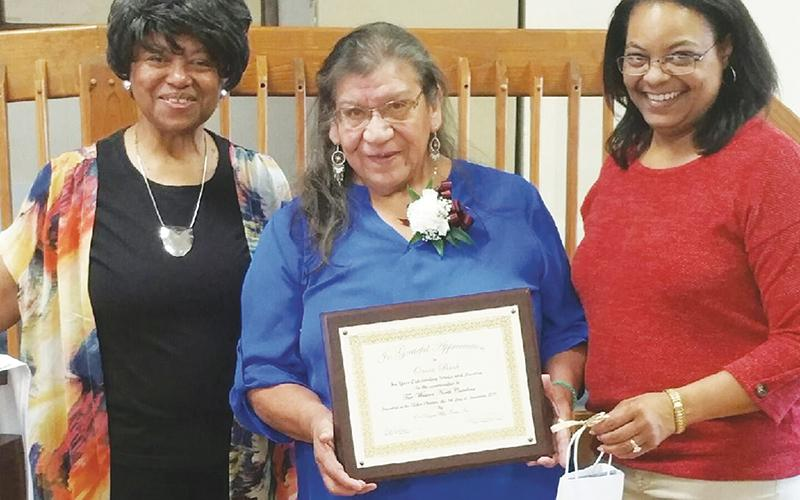 Snowbird resident Onita Bush (center) was presented with the One Dozen Who Care's Community Treasure Award on Saturday, Nov. 9. With Bush is organization founder Ann Miller Woodford and director Dawn Colbert.