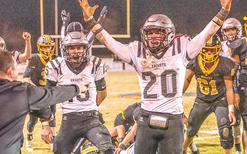 Coach Lucas Ford (left) can't contain his excitement as Clayson Lane (15) and Lex Hooper (20) rejoice in the moment Friday night at Murphy, after Robbinsville moved the chains for the final time in a Smoky Mountain Conference title-clinching 17-14 win over the Bulldogs. Photos by Byron Housley/The Graham Star