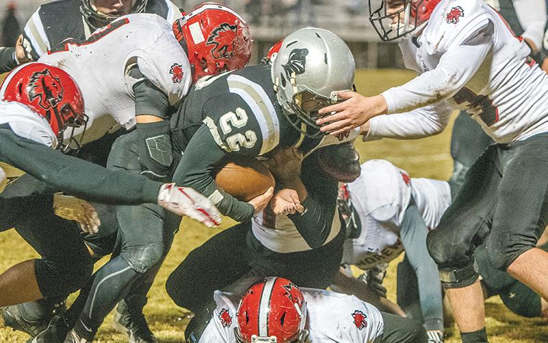 Surrounded by a pack of Wildcats – six to be exact – Robbinsville senior Rylee Anderson trucks ahead during Friday's 28-7 win over Andrews. Anderson broke the all-time Black Knights rushing record in the fourth quarter of the game. Photo by Byron Housley/The Graham Star