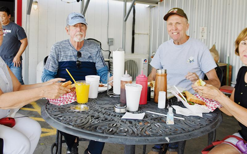 The Hub has a wide range of notoriety, as evidenced by Roberta Guendelsberger, Tim Dowling, and David and Susan Picz (from left) of Palm Shore stopping to dine in Saturday.