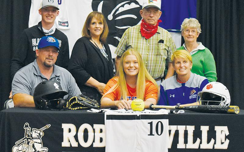 Robbinsville's Maggie Knight (seated, center) signed her letter of intent to play softball at Chattanooga State on Tuesday, Nov. 10. Sitting with Maggie is father Billy and mother Joanne Knight. Standing in back (from left) are cousin Alex Knight, aunt Angie Knight, and grandparents Randy and Velvie Knight. Photo by Kevin Hensley/editor@grahamstar.com