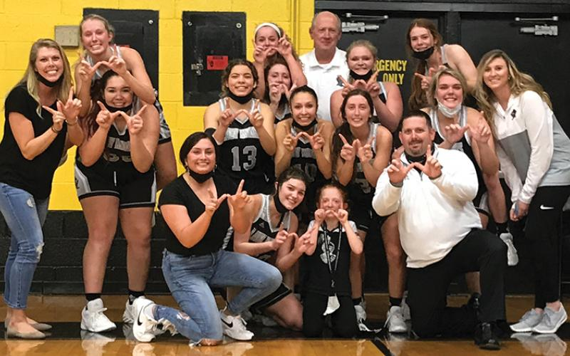 Robbinsville Lady Knight players and staff gather to celebrate the program's first Smoky Mountain Conference title since 2010, clinched tonight with a 67-50 win at Murphy. Photo by Kevin Hensley/editor@grahamstar.com