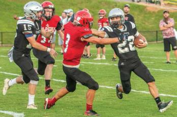 Andrews' Gage Gillespie (3) meets the stiff-arm of Robbinsville's Rylee Anderson during Friday's scrimmage at Big Oaks Stadium.