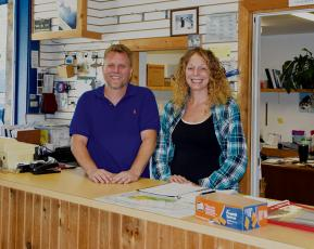 Jim Suprinski (left) and Diana Cole-Joerns moved from Illinois to live their dream of owning their own business. The couple now owns The Boat & Auto Shop on Tallulah Road. Photo by Art Miller/amiller@grahamstar.com
