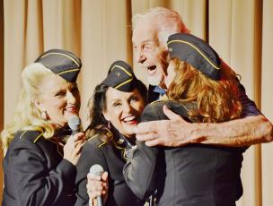 World War II veteran Mel Greene joined Ladies for Liberty (from left) Wanda R. Martin, Deanna Hampton, Nancy Cheak on-stage at the Stecoah Valley Center on Sunday. Photos by Art Miller/amiller@grahamstar.com