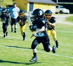Conner Hyde finds some real estate during PeeWee action at Murphy on Saturday. Photo by Jenny Millsaps