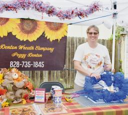 Peggy Denton of Denton Wreath Company was one of many vendors on-hand for the third annual Robbinsville Fall Arts & Crafts Festival on Saturday. Photo by Art Miller/amiller@grahamstar.com