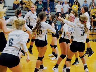 Jubilation sets in for the Robbinsvlle Lady Knights, moments after a thrilling 5-set  victory over Murphy on Sept. 5. Photo by Kevin Hensley/editor@grahamstar.com