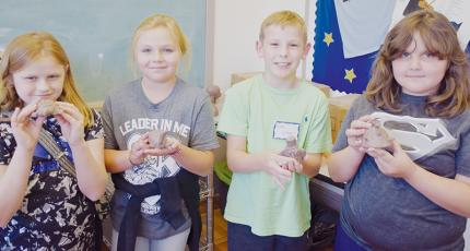 Katie McCracian, Sydney Adams, Cody Crisp and Ella Atwell (from left) show off the clay artwork they created at last week's Arrowmont Program, held at the Stecoah Valley Cultural Arts Center. Photo by Art Miller/amiller@grahamstar.com