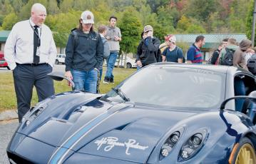 Robbinsville High School principal David Matheson (left) and senior Christopher Shope behold a Pagani automobile that visited the campus Oct. 16. Photos by Art Miller/amiller@grahamstar.com