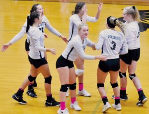 Lady Knights Kennedy Cable, Karlyn Matheson, Liz Ayers, Yeika Jimenez, Gracye Burchfield and Karcee Dooley (from left) celebrate after a point during Oct. 10's sweep against Rosman. Photo by Kevin Hensley/editor@grahamstar.com