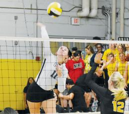 Robbinsville senior Karlyn Matheson prepares to drive one of her team-leading 29 kills onto the Murphy side of the net during Oct. 3's road match. Photo by Noah Shatzer/Cherokee Scout