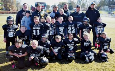 The Robbinsville PeeWees were all smiles after winning the Cracker Bowl championship Saturday in Franklin. Photo by Jenny Millsaps/Contributing Photographer