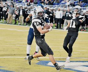 Robbinsville senior Rylee Anderson crosses the threshold for one of his five rushing touchdowns during Saturday's 1A state championship game against Northampton County. Photo by Kevin Hensley/editor@grahamstar.com