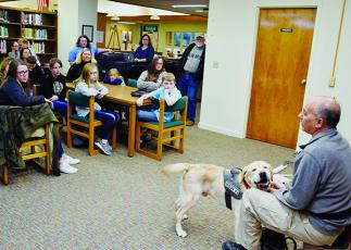 Dean Castaldo and his arson companion Dante (right) present a Fire Prevention Class at the Graham County Public Library on Monday. Photo by Art Miller/amiller@grahamstar.com