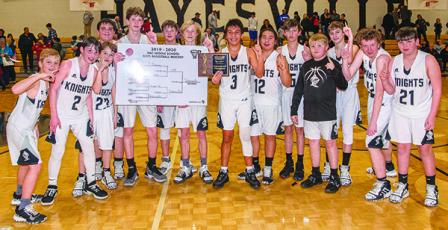 The Robbinsville Middle School Black Knights pose with the 2019-20 championship tournament bracket, moments after defeating the Hiwassee Dam/Ranger Eagles to win the title on Jan. 23 in Hayesville. From left are Dane Knott, Roman Jones, Luke Lovin, Tytan Teesateskie, Donovan Carpenter, Bryce Adams, Zeke Silvers, Xander Wachacha, Quinn Jumper, Andrew Scrivner, Drake Anderson, Austin Colangelo, Hugh Forbes and Isiac Collins. Photos by Byron Housley/The Graham Star