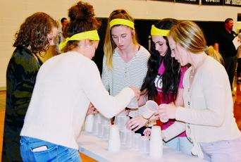 Bethany Collins, Lina Pagan, Bri Hooper, Willow Trantham and Anna Riddle (from left) made up the winning team during Monday's ACT stress-release competition at  Robbinsville High School. Photo by Art Miller/amiller@grahamstar.com