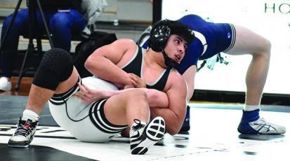 Robbinsville's Jaret Panama has Mount Airy's Luke Leonard down for the count in the 170-pound bout of Tuesday's second-round state dual. Photo by Kevin Hensley/editor@grahamstar.com