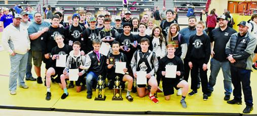 Members of the Robbinsville High School wrestling program come together to celebrate Saturday's Smoky  Mountain Conference Tournament championship. Photos by Kevin Hensley/editor@grahamstar.com