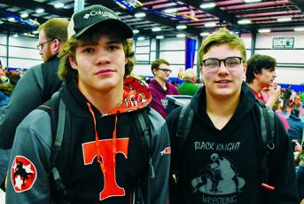 Robbinsville Middle School's Kage Williams (left) and Koleson Dooley pause between bouts at Saturday's state championship tournament in Concord. Photo by Kevin Hensley/editor@grahamstar.com