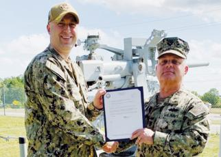Navy veteran and Graham County resident Jason Marino (right) was recently  promoted to Master Chief. Presenting Marino with his Frocking Letter is Commander Henderson.