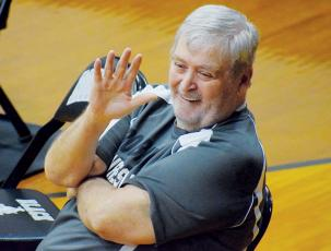 Right at home while sitting at the edge of the mat, George Oliver waves to spectators before the start of a Robbinsville match. The co-founder of the Black Knights' wrestling program passed away Aug. 5. Photos by Jenny Millsaps/The Graham Star