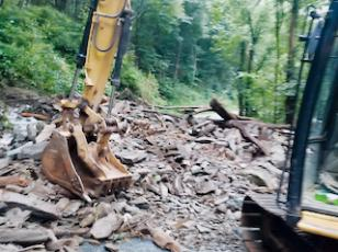 Crews began working at sunrise Saturday to clear a mudslide in the Nantahala Gorge, which occurred after heavy rainfall Friday. Photo courtesy of N.C. Department of Transportation