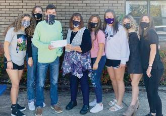 The Robbinsville High School Student Council raised and donated $100 toward the purchase of the food truck for Graham County Schools. From left in the photo is Robbinsville Student Council members Lina Pagan, Lindsey Brittain, Student Body President Dalson Jordan, Graham County Schools Superintendent Angie Knight, Ally Ayers, Ivy Odom, Caylin Lunsford and Keylie Jordan.