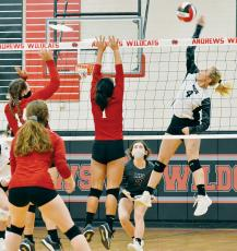 Kensley Phillips shows off her vertical prowess while rising for the kill Monday at Andrews. Photos by Kevin Hensley/editor@grahamstar.com